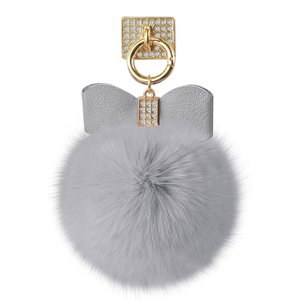 REIKO PHONE HOLDER/ FINGER LOOP GRIP WITH RHINESTONE SOFT PUFFY FUR BALL IN GRAY